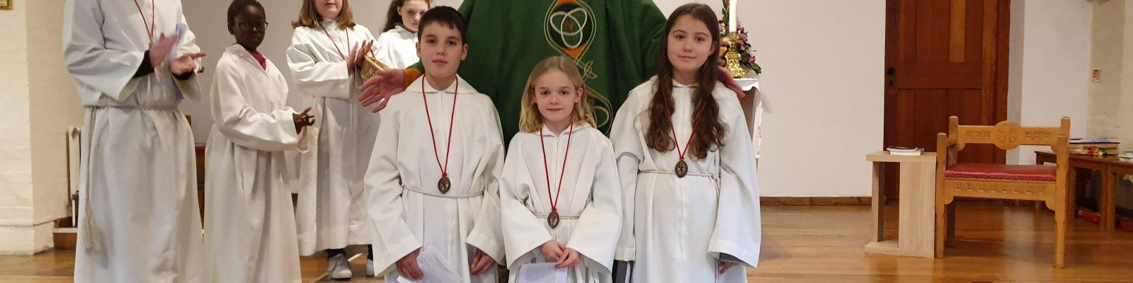 Altar Servers receiving their guild of St Stephen medals.
