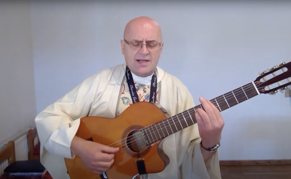 Fr Zbigniew Playing Guitar